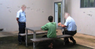 Photo of briefing a youth in a lockup before a transport