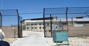 Image of gates separating Hakea Juvenile Facility from adult section of Hakea Prison