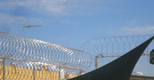 Picture of razor wire over top of shade sails