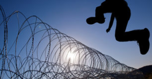 Man leaping razor wire