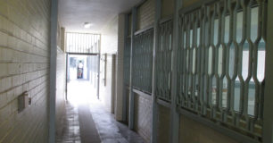 External corridor with bars on windows between units
