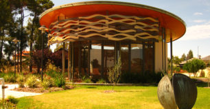 A circular enclosed building, with seating for spiritual meetings for all religions