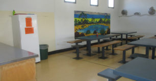 Image of a room with tables and seating for Prisoner's at Acacia Prison