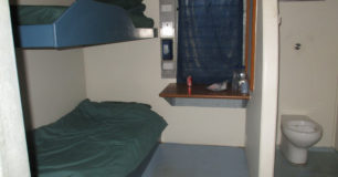 A double-bunked cell with a toilet at Acacia Prison