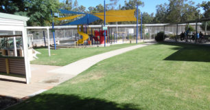 Image of outdoor childrens play ground, and seating area at visitors centre