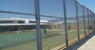 Image of prisoners at Casuarina Prison in a fenced in recreation yard.