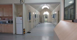 Image of a corridor with cells either side at the crisis care unit.