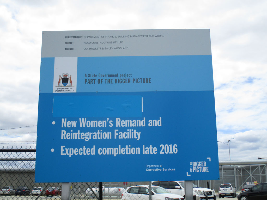 """Image of a sign about the """"New Women's Remand and Reintegration Facility"""" outside Melaleuca"""
