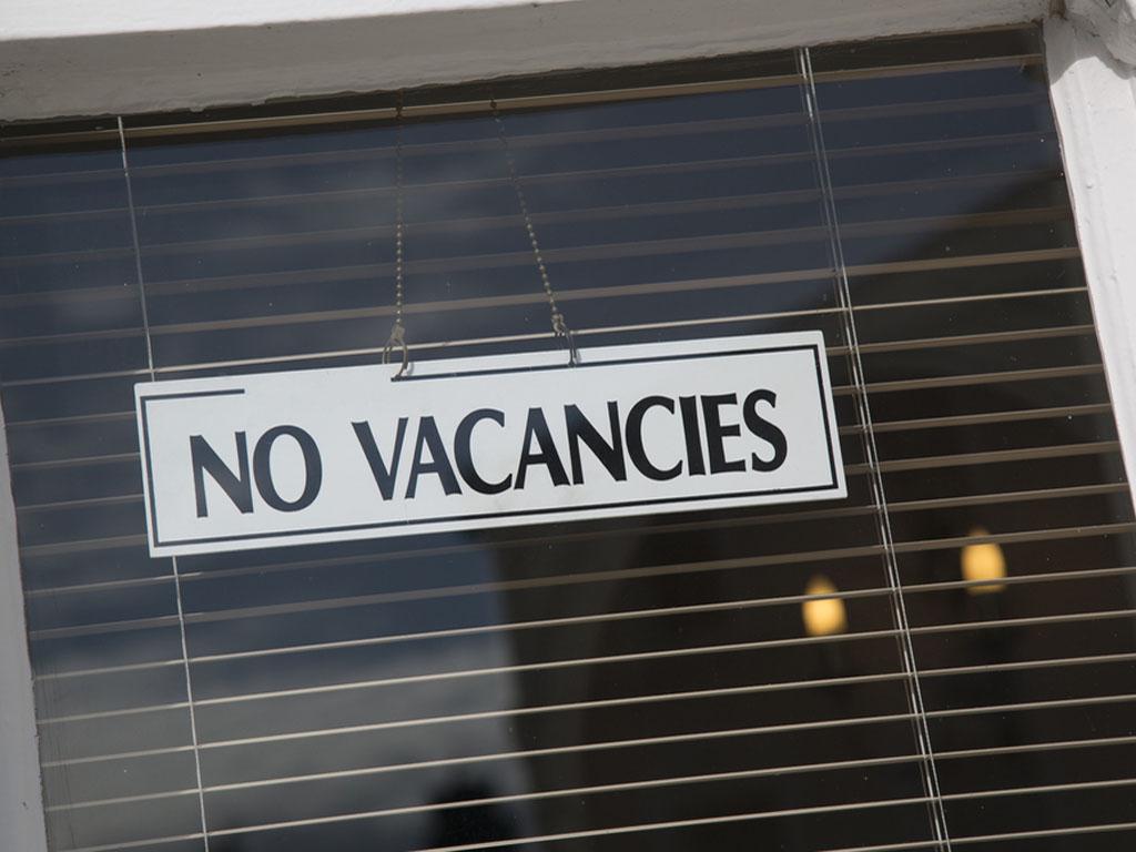 No vacancy sign in window