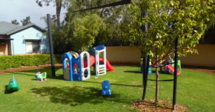 Image of childrens toys on the grass outside residents communal houses at Boronia Pre-release Centre for Women
