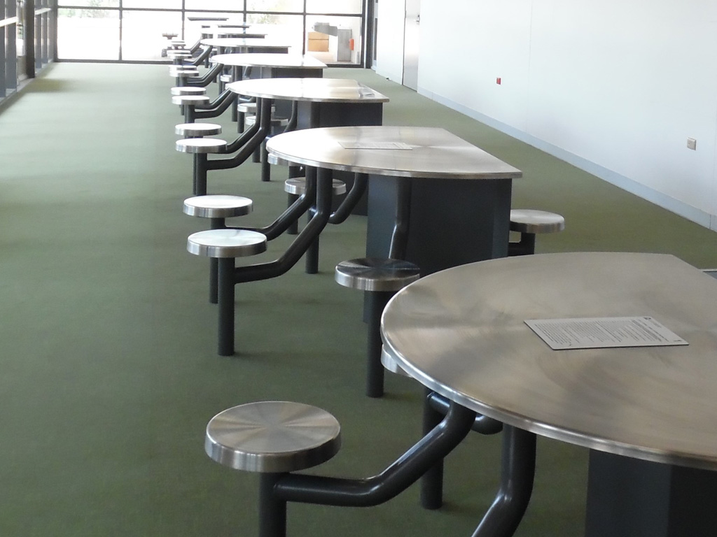 Six empty visitor tables in prison visits centre