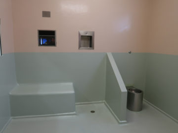 Image of a Seat and toilet in a court custody cell