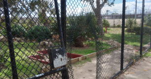 Image of the breached fence in Unit 4