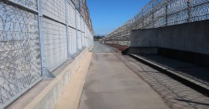 Image of razor wire perimeter fencing at Casuarina Prison