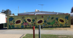 Image of a mural on a sea container behind reception building at Bandyup Women's Prison