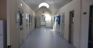 Image of crisis care with cell doors either side of the corridor