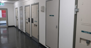 Image of Reception corridor with closed holding cell doors at Eastern Goldfields Regional Prison