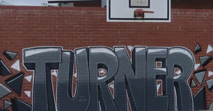 Graffiti art of the name 'Turner' on wall in the basketball court