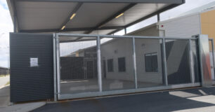 Image of the outside gate looking through to the Sallyport at Melaleuca Women's Prison